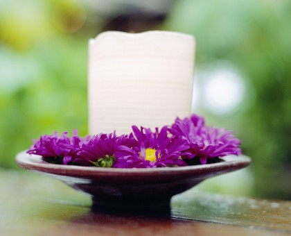Flowers Surrounding White Candle